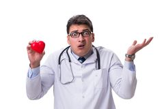 Young male cardiologist doctor holding a heart isolated on white. Background Stock Photo