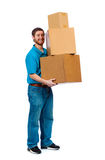 Young male carrying moving boxes royalty free stock image