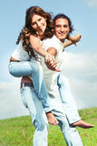Young male carrying woman Stock Photos