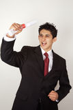 Young male celebrating academic success Royalty Free Stock Photo