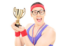 Young male champion holding a trophy Stock Image