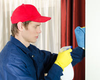 Young male cleaner with tools. Royalty Free Stock Photo