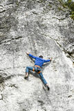 Young male climber climbing a route on a rock. Jura krakowsko chestochowska. Stock Photography