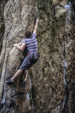 Young male climber leading a route on a rock. Sokoliki, Poland. Stock Photos