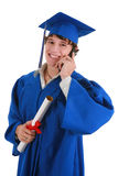 Young Male College Graduate Making Phone Call Royalty Free Stock Photo