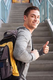 Young male college student with backpack Royalty Free Stock Photos