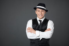 Young male confident male posing in gangster style suite. Royalty Free Stock Photo