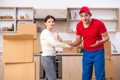 Young male contractor and female customer in moving concept royalty free stock image