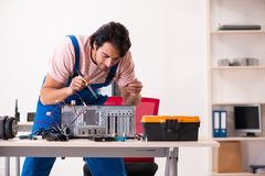 The young male contractor repairing computer stock images