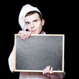 Young Male Cook With Copyspace Menu Chalk Board Royalty Free Stock Images