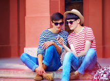 Young male couple chatting through the mobile device Stock Photo