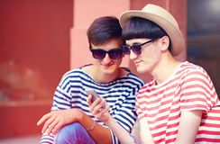 Young male couple chatting on mobile device Stock Image