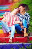 Young male couple on rainbow stairs Stock Image