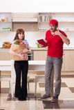 The young male courier in food delivery concept stock photos