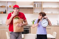 The young male courier in food delivery concept stock photo