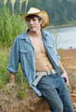 A young male cowboy. A young attractive man dressed as a cowboy stock photography