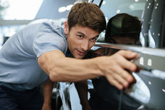 Young male customer examining a new car royalty free stock images