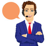 Young male customer support phone operator with arms folded and speech bubble Royalty Free Stock Photo