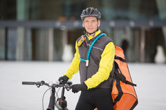 Young Male Cyclist With Courier Delivery Bag Royalty Free Stock Image
