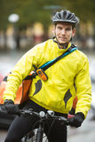 Young Male Cyclist With Courier Delivery Bag On Royalty Free Stock Photo