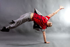 Young male dancer. Young male modern freestyle dancer balanced on one hand royalty free stock photography