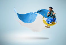 Young male dancer jumping with splash of paint Stock Image