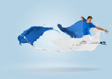 Young male dancer jumping with splash of paint Royalty Free Stock Photo