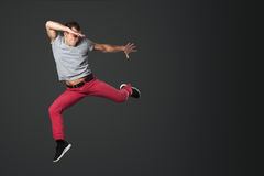 Young male dancer jumping in studio. Stock Photo