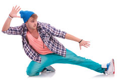 Young male dancer performing. Posing in a sliding position, looking away from the camera Royalty Free Stock Photography