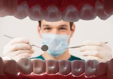 Young male dentist Stock Images