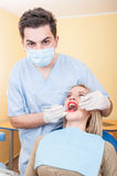 Young male dentist at work Stock Photography