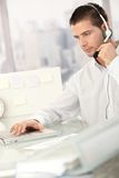 Young male dispatcher working in office Stock Photo