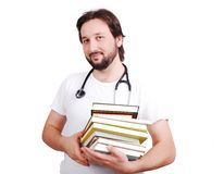Young male doctor with books in hands Stock Photography