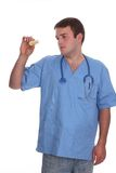 Young male doctor checking a sample Stock Photos