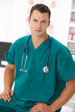 Young male doctor in consulting room Royalty Free Stock Image