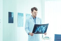 Young male doctor examining checking chest x-ray radiography film of patient at ward hospital.Medical surgery and orthopedics. Health care concept royalty free stock photos