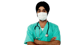 Young male doctor with face mask Royalty Free Stock Photos