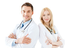 Young male doctor and female nurse in hospital Royalty Free Stock Photos