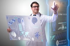 The young male doctor in futuristic medical concept stock image