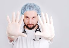 Young male doctor with hands in front and surgery Stock Images