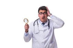 Young male doctor with a looking magnifying glass isolated on wh. Ite background Stock Photos