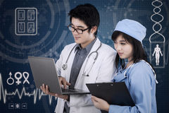 Young male doctor and medical assistant Royalty Free Stock Photography