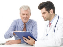 Young male doctor with old patient Royalty Free Stock Photos