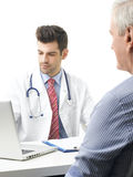 Young male doctor with old patient Stock Photos