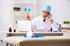 The young male doctor otolaryngologist working at the hospital stock photography