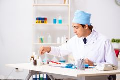 The young male doctor otolaryngologist working at the hospital. Young male doctor otolaryngologist working at the hospital stock photography