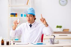 Young male doctor otolaryngologist working at the hospital. The young male doctor otolaryngologist working at the hospital royalty free stock image