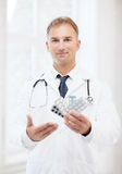 Young male doctor with packs of pills Royalty Free Stock Photo