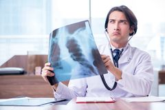 The young male doctor radiologist working in the clinic. Young male doctor radiologist working in the clinic royalty free stock photography