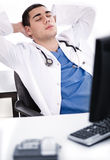 Young male doctor relaxing at his cabin Royalty Free Stock Photography